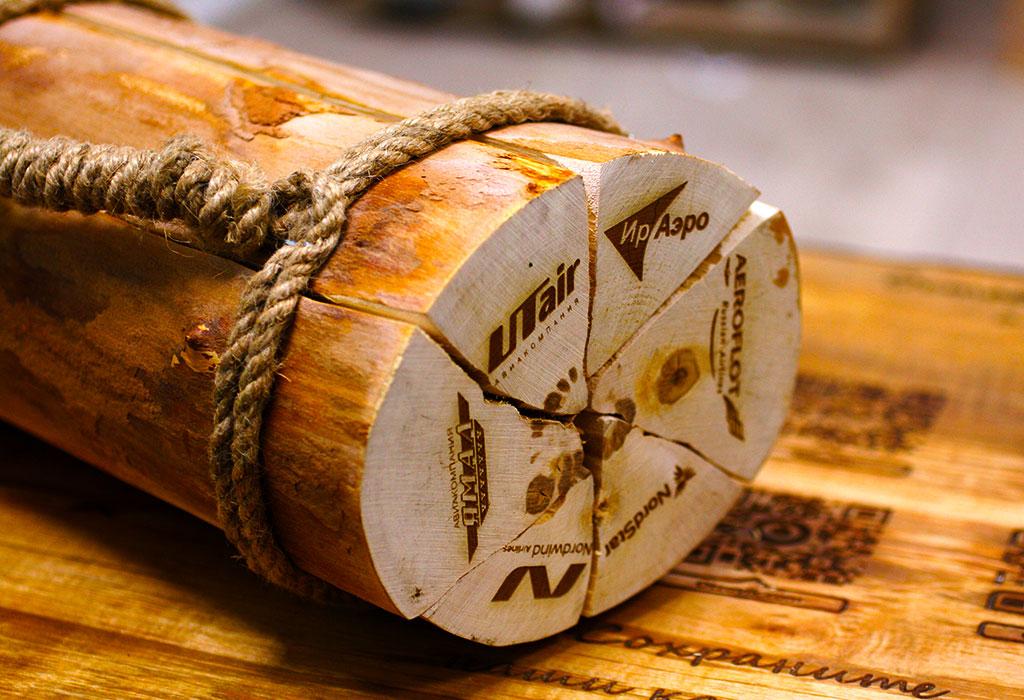 Гравировка логотипа на дровах